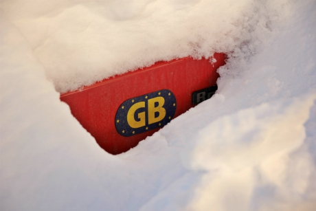 GB sticker on a car buried in snow