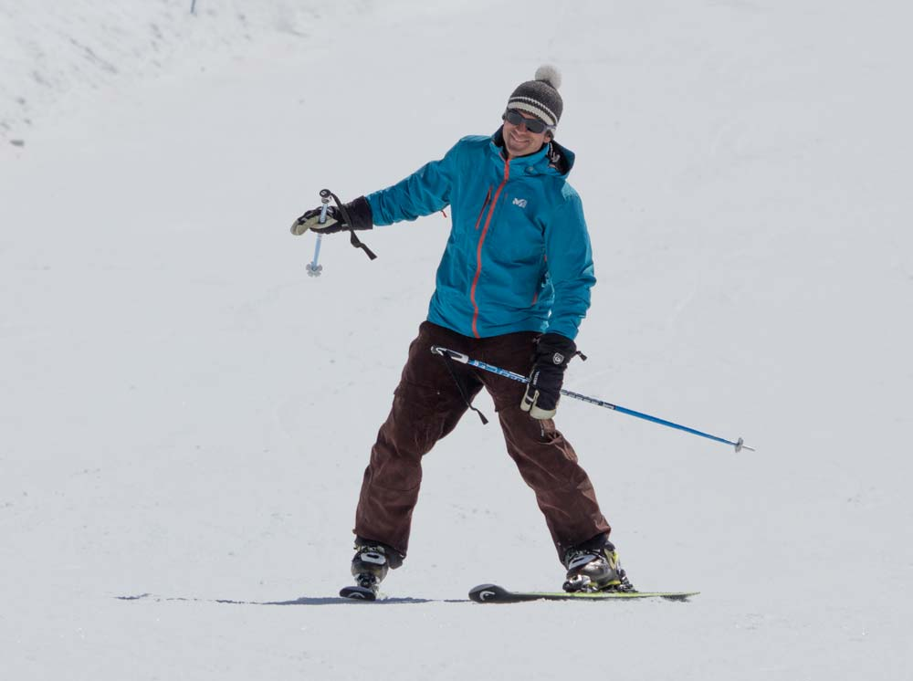 Outside hand down when skiing