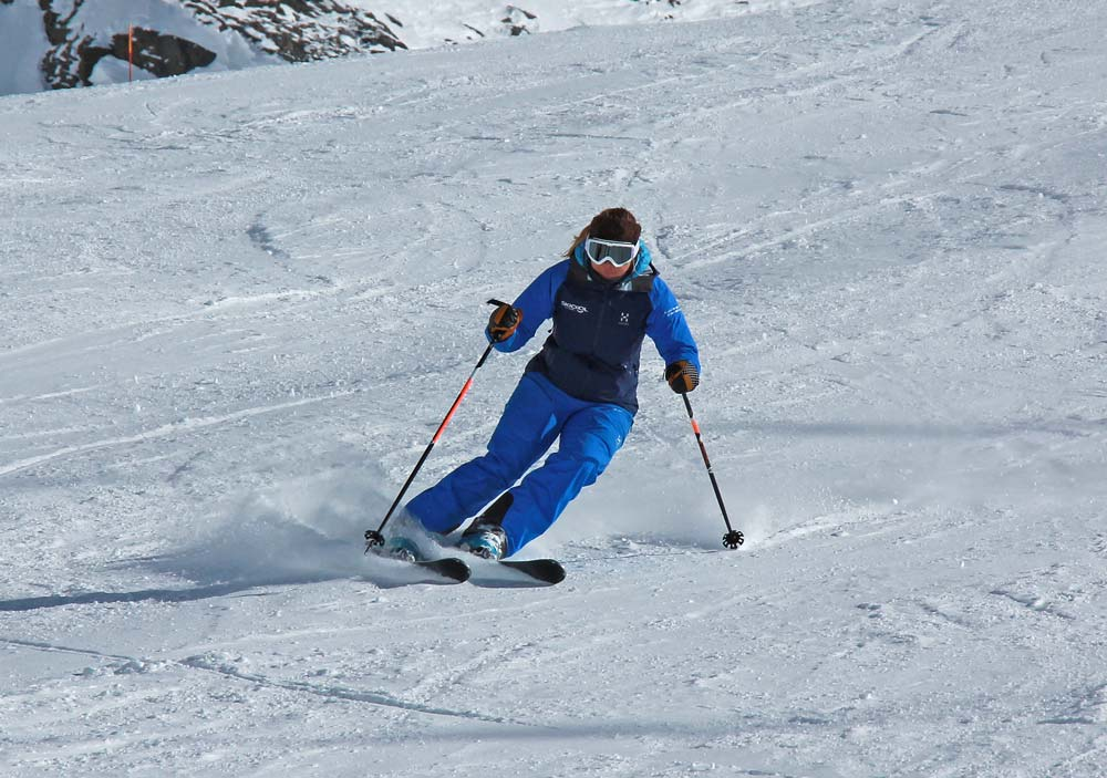 Leaning to edge the skis